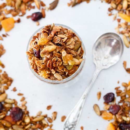 This Honey Harvest Granola is easy to make and packed full of healthy ingredients such as nuts, chia seeds, coconut oil, and molasses. Great on yogurt or as a crunchy snack. Recipe at www.designsofanykind.com