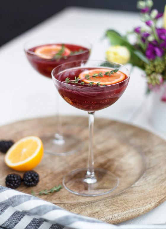 This chic cocktail pairs fresh blackberries with thyme, tequila and sparkling rosé leaving your taste buds in a state of pure love and happiness! Recipe at www.designsofanykind.com