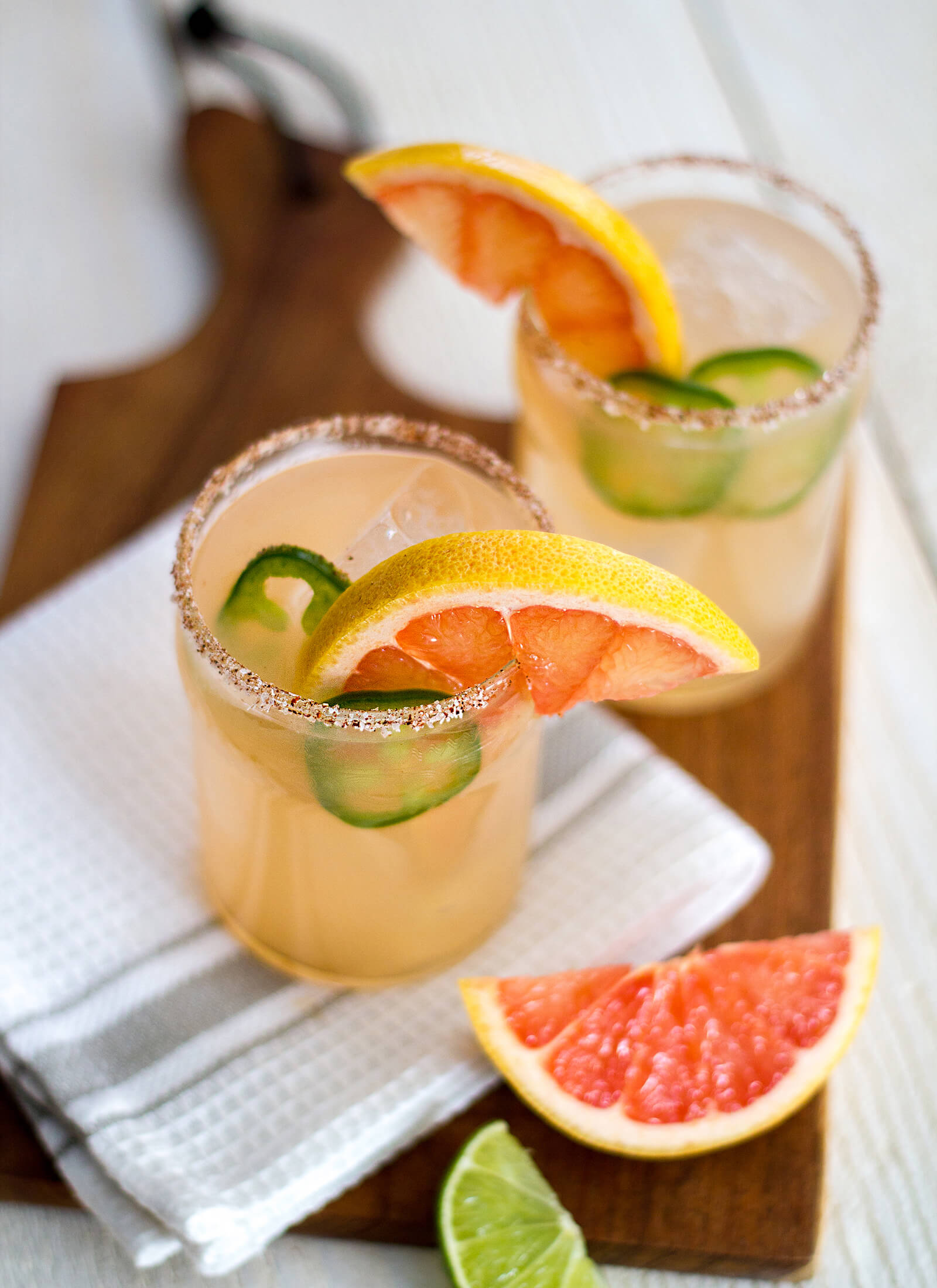 Easy-to-make grapefruit margaritas with a spicy kick! If you're a tequila lover and you like spicy food—the spicy grapefruit margarita won't disappoint. Recipe at www.designsofanykind.com