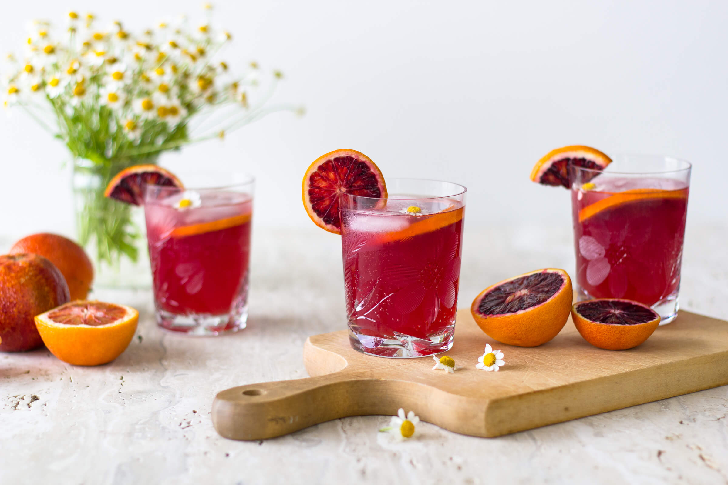 A beautiful and delicious twist to the traditional Moscow Mule cocktail. These Blood Orange Moscow Mules are easy, smooth and oh so refreshing! Recipe at www.designsofanykind.com
