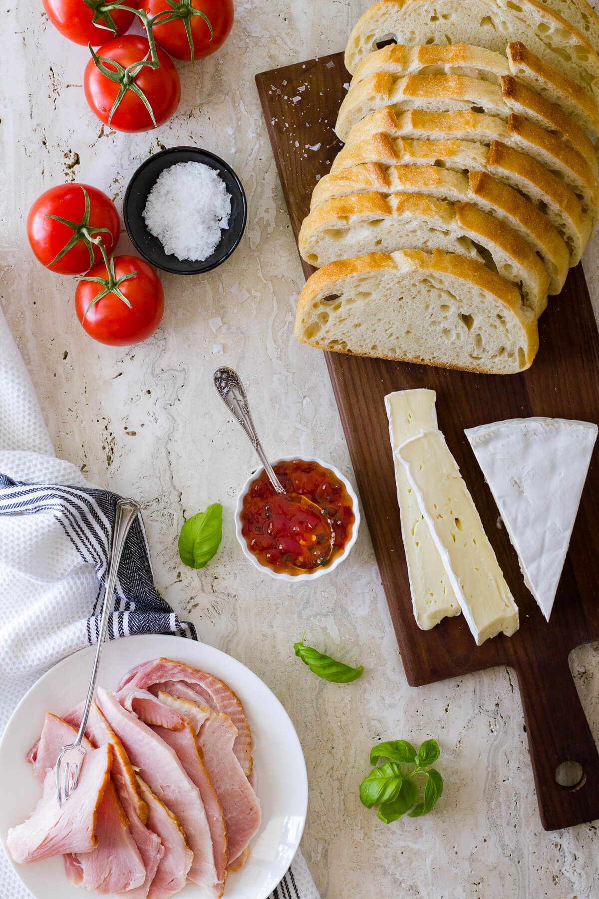 Take your grilled cheese experience to the next level with a cedar plank grilled Hot Brie Melt sandwich. Mouthwatering flavors of spicy pepper jelly, basil, brie cheese, tomatoes, and ham are the perfect combination! Recipe at www.designsofanykind.com